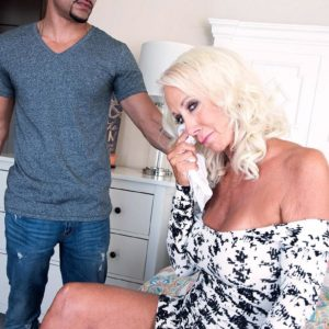 Phat sixty plus MILF Madison Milstar entices a younger black boy in a cock-squeezing fitting sundress