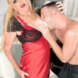 Blonde Nan Charlie seduces a younger stud in lingerie and ebony stockings