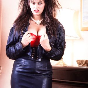 Dark-haired solo model Jeannine Oldfield unleashes her monster-sized funbags in leather and pantyhose