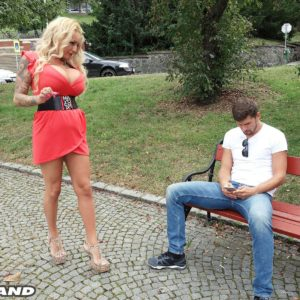 Golden-haired beauty Bambi blacks tempts a stud on a park bench in a short dress