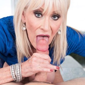 Kinky 60 plus MILF Leah L'Amour seduces a junior guy in the sauna before giving a BJ