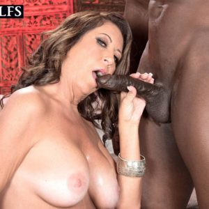 Older doll Karen DeVille is undressed by a black guy before taking his big black cock in hand