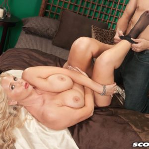 Older sandy-haired MILF Karen Fisher is unclothed of her lingerie and tights by her lover