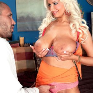 Platinum blonde MILF Holly Brooks tempts a dude with her immense melons in a mini-skirt