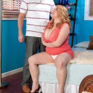 Redhead big hot lady Sadie Berry entices a dude by showcasing upskirt cotton underwear
