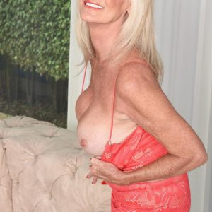 Sixty plus MILF Leah L'Amour tempts a junior boy at the door with her immense fun bags out