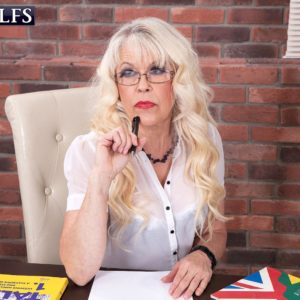 Uber-sexy mature instructor Dame S tempts a male student in a black mini-skirt and glasses