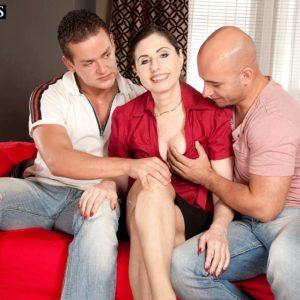 Aged MILF Lorenzia has her vag and bum fondled by her junior lovers on a chesterfield