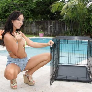 Black-haired girlfriend Adriana Lily pegs her sissy over a dog cell on poolside patio