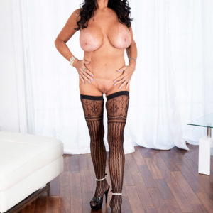 Grannie XXX star Rita Daniels bares her immense tits before slurping and draining a poke stick