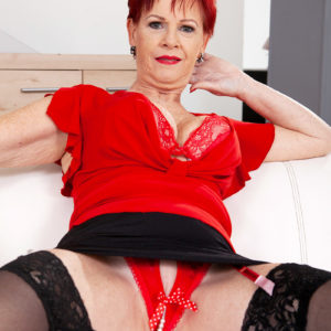 Over 60 red-haired Caroline Hamsel plays with her tits garmented crotchless skivvies