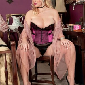 Sandy-haired MILF Rockell bares her enormous breasts in mind-blowing lingerie before donning tights