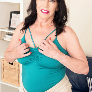 Sixty plus MILF Christina Starr reveals her sagging titties as she gets fully nude
