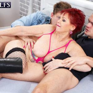 60 plus redhead Caroline Hamsel entices a couple of guys on the street in slutwear