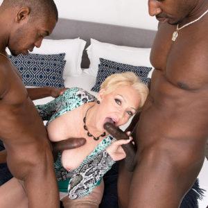 Beautiful yellow-haired grandma Seka Black deep throats on a couple of huge black hard-ons during MMF sex
