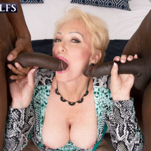 Beautiful yellow-haired grandma Seka Black deep throats on a couple of huge black hard-ons during MMF sex