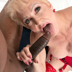 Bosomy golden-haired granny Seka Black holds a Peeping Tom's humungous ebony cock in her hand