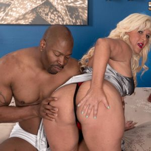 Chubber older ash-blonde Lori Suarez bares her hefty ass from silk lingerie for her ebony lover