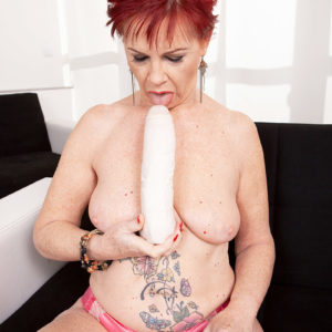 Ginger-haired grannie Caroline Hamsel eats and gargles her bevy of sex toys in skivvies