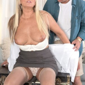 Gorgeous older broad Dallas Matthews exposes her lace panties while seducing a boy