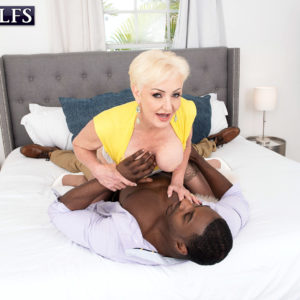 Platinum ash-blonde grandma Seka Black deep-throats off a junior man's immense black dick