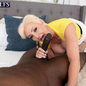 Platinum ash-blonde grandma Seka Black deep-throats off a junior man's immense black dick