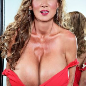 Asian solo model Minka releases her enormous boobies from a crimson dress afore a mirror