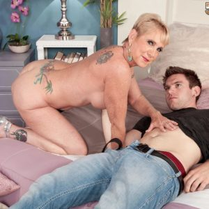 Elder gal Honey Ray sports short yellow-haired hair while stroking on a youthfull boy's penis