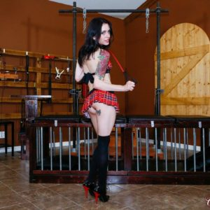 Inked solo model Anna Lee demonstrates upskirt buns in ebony over the knee boots