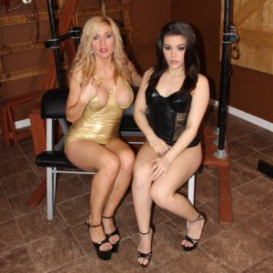 Kimber Woods and a enticing gf pee into a bowl limited by a collared masculine sub