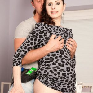 Long-limbed cougar Lorenzia tempts the handyman in a short dress and hosiery