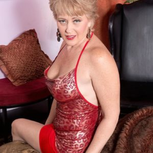 Fabulous mature woman Tracy Blow is liberated from a taut sundress before having her hard nipples munched
