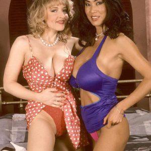 Sapphic porno stars Minka and Danni Ashe tongue smooch before rubbing hefty tits and flashing underwear
