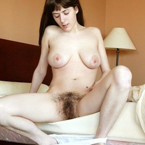 Brown-haired first-timer tweaks her hard nips before unleashing her ultra-cute ass and furry pussy
