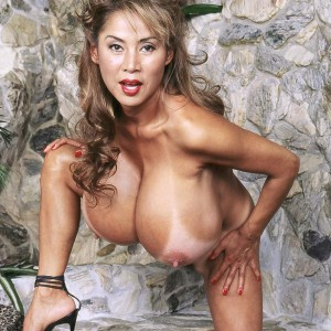 Elderly Asian broad Minka displays her enormous tits before unveiling her hairless cunny
