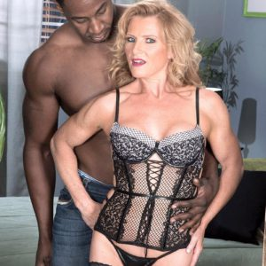 Elderly golden-haired Amanda Verhooks greets her younger black lover in sumptuous lingerie