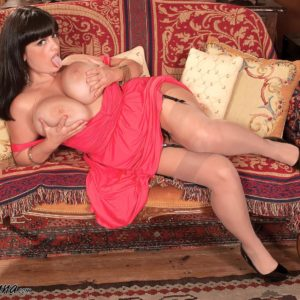 Fatty solo model Arianna Sinn lets her gigantic titties loose from a sundress in tan hose