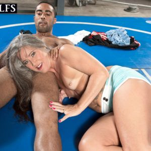 Fit aged doll Leilani Lei deep-throats her individual trainer's ebony cock on a grappling pad