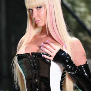 foxy fair-haired dominant Alexia Jordon rides a hooded male slave in spandex by the pool