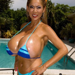 Huge-chested Chinese lady Minka models a pair bikinis outdoors in close proximity to a pool