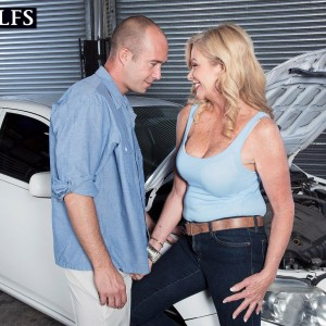 Over 50 ash-blonde Lauren Taylor has her big tits and ass uncovered by while in a garage