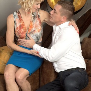 Over Fifty golden-haired Molly Maracas exposes her enormous breasts before eating a cock on knees