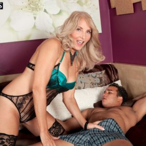 Senior yellow-haired Chery Leigh seduces her junior lover in fantastic lingerie and hose