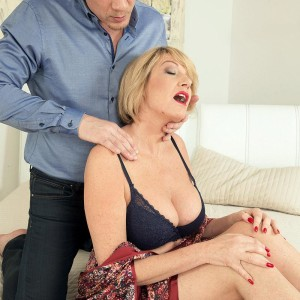 Aged light-haired lady Amy goes stripped to the waist after being fed berries and receiving a neck grope