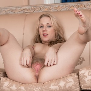 All natural fair-haired Aston Wildegets naked on a chesterfield before spreading her hairy coochie