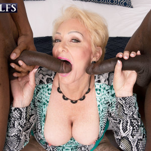 Alluring sandy-haired grandmother Seka Black deep throats on a duo of massive ebony pricks during MMF sex