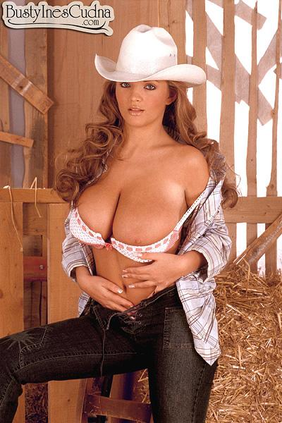 Babe Ines Cudna letting monster-sized boobies free in jeans and cowgirl hat in barn