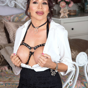Beguiling grandmother Lisa Marie Heart tempts a younger dude in a choker and restrain bondage harness