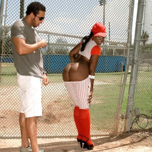 Black chick Kali Desires letting massive ass free from baseball uniform outdoors