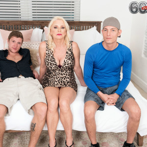 Blonde grandma Cammille Austin wanks a pair of sausages after seducing guys in a dress